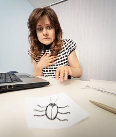Woman scared cockroach drawn on paper Standard-Bild