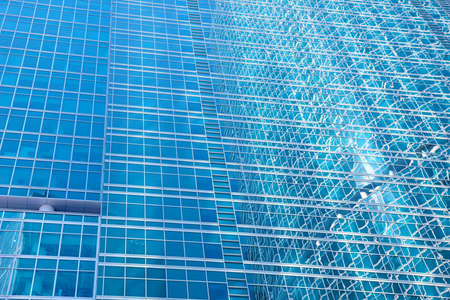 The walls and windows of a skyscraper - an abstract urban background photo