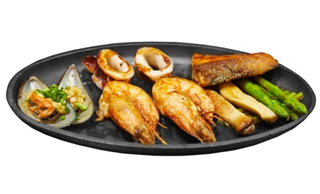 exotics: Seafood steak with prawns mussels and salmon isolated on white background