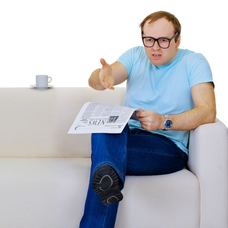 Funny man dissatisfied with news from the newspaper isolated on white background photo