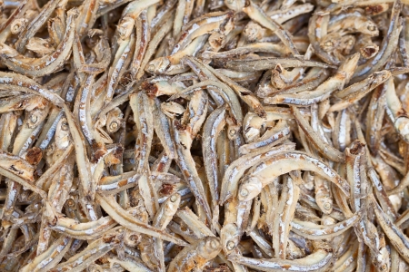 dried fish: Whitebait on the market counter - edible anchovies background