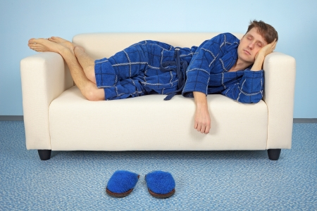 tiredness: The man is resting at home after a hard days work Stock Photo