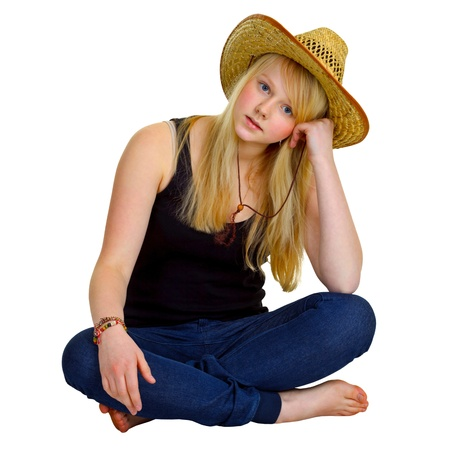 Blonde girl dressed in a rustic style isolated on white background photo