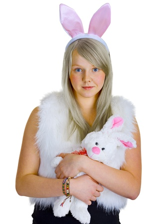 A young blonde in a fancy-dress with toy rabbit isolated on white background photo