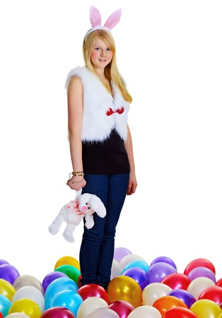 A young woman with a toy rabbit isolated on white background photo