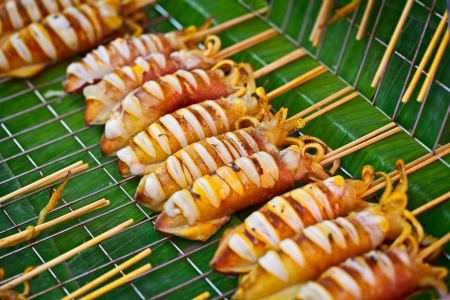 Grilled squids sold on the street asian market photo