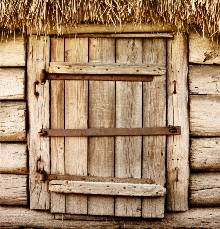 Wooden door of old rustic cabin photo