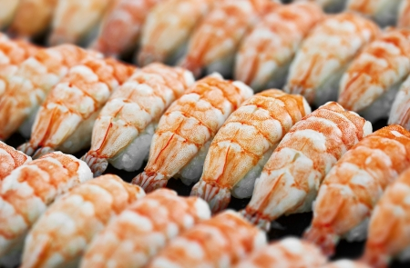 Japanese cuisine, shrimp sushi on tray photo