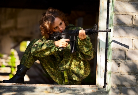 old rifle: A young woman with a rifle on maneuvers Stock Photo