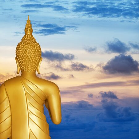 The gold Buddha statue at sunset. Rear view. photo