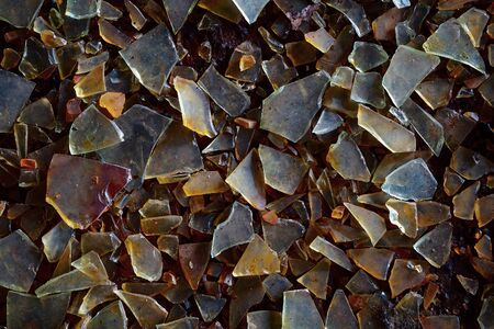 Old dirty glass shards on the ground - industrial waste grunge background Stock Photo - 16786884
