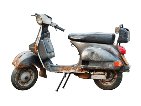 Old rusty scooter isolated on white background