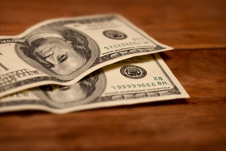 two dollar bill: Dollars on wooden table close up. Shallow depth of field Stock Photo