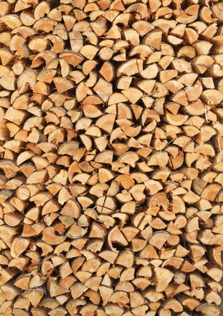 log fire: A stack of birch firewood - a natural vertical background Stock Photo