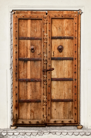 An old dilapidated wooden door of Indian home photo