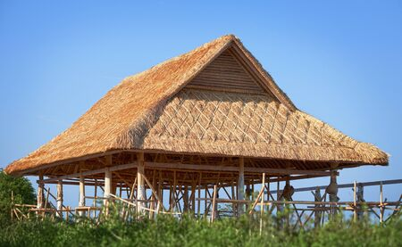 Traditional bamboo roof under construction. Indonesia photo