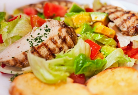 The grilled chicken with vegetables close up photo