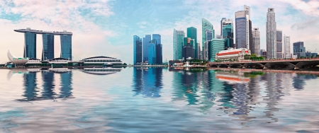 singapore skyline: Singapore skyline -modern skyscrapers with reflection in water