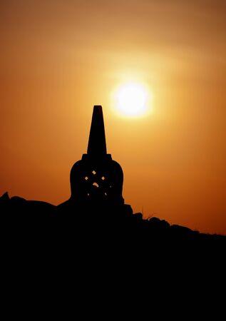 buddhist stupa: Decorative Buddhist stupa. Silhouette at sunset. Indonesia. Stock Photo