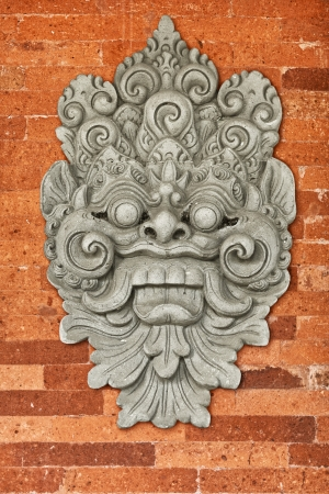 Stone bas-relief on the brick wall of the old church. Indonesia, Bali. photo