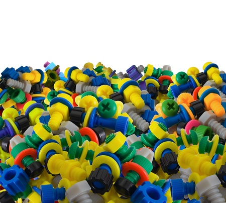 Color toy plastic bolts and nuts on white background photo
