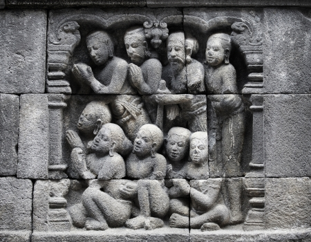Detail of traditional asian Buddhist carved relief at Borobudur temple on Java, Indonesia photo