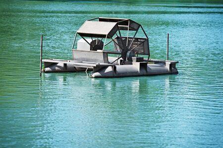 chai: Chai Pattana aerator on clean blue lake water. Thailand, Bangkok