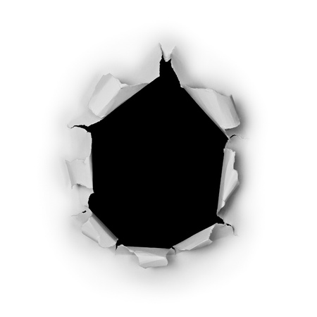Breakthrough torn big black hole in rough paper isolated on white background. 写真素材