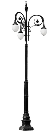 Victorian vintage iron black lamp post standing on white background photo
