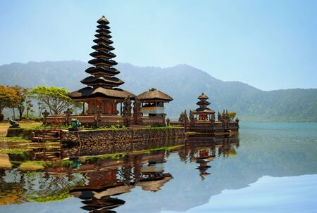 Pura Ulun Danu Bratan hindu temple on blue lake, central Bali, Indonesia photo