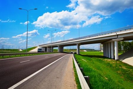 Road junction with bridge overpass under highway