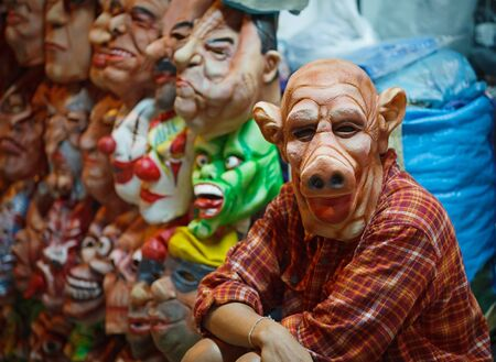 The seller latex masks for Halloween on the open market photo