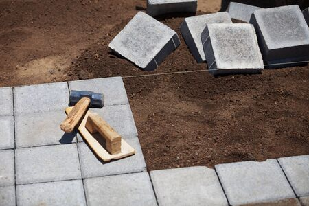 concrete block: Block pavement under construction with working tools