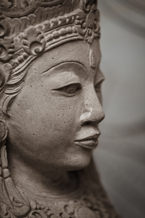 Face of stone woman close up - old sculpture. Indonesia. photo