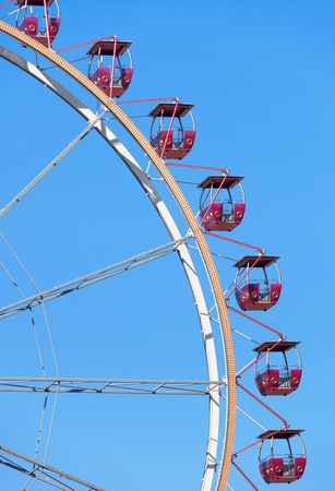 Ferris wheel on the blue sky background photo