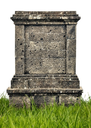 Large headstone monument in grass covered with mold on the white background photo