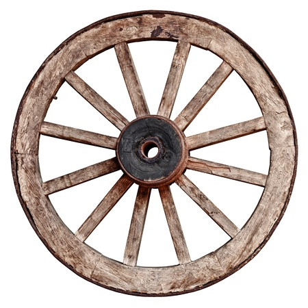 Old wooden wagon wheel isolated on white background photo