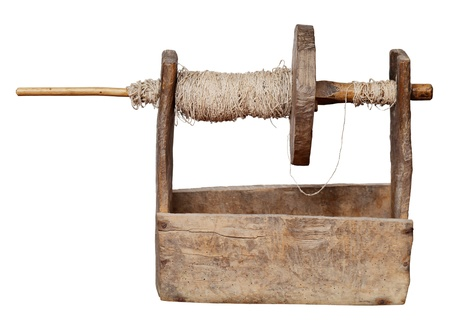 Ancient ukrainian wooden reel machine - a tool for the production of yarn isolated on white background photo