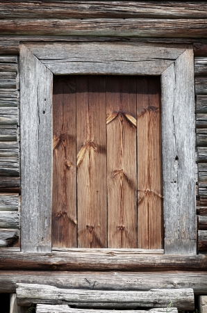Old grunge wooden rural door close up photo