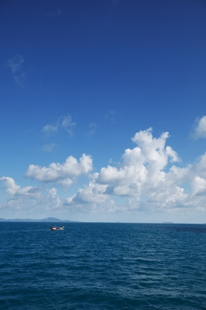 Small old fishing boat in the ocean. Thailand photo