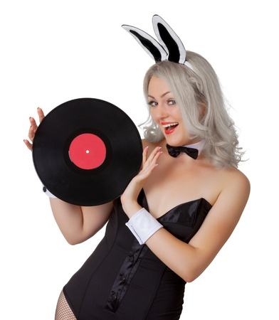 Playful blonde in a bunny suit with a vinyl record in the hands isolated on white background photo