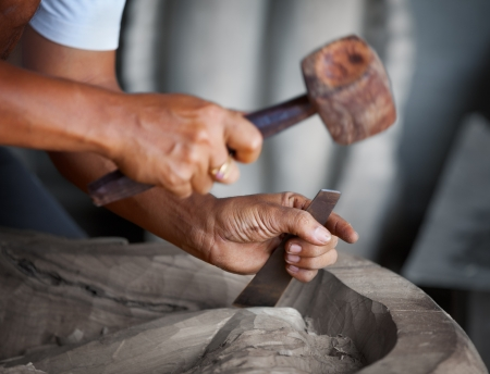 Hands woodcarver while working with the tools photo