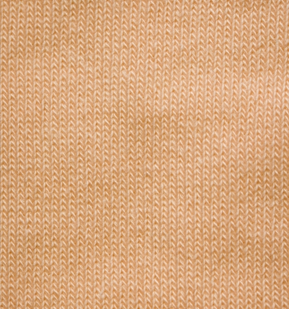 Yellow pattern of woolen soft fabric - knitted wool texture photo