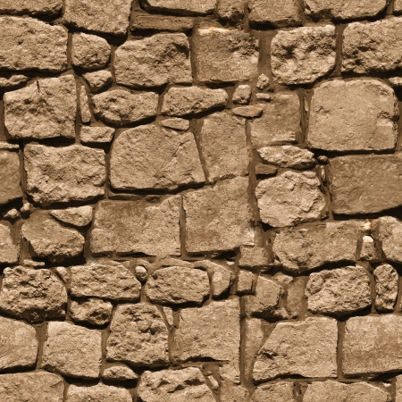 The wall of the large rough natural stone - seamless texture for design Stock Photo