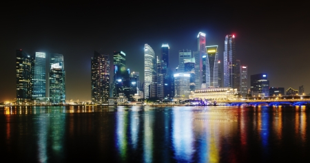 city by night: Night Singapore skyscrapers shines with electric lights