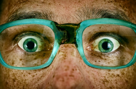Frightened look of a man in old glasses close up Stock Photo - 21061791