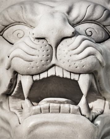 marbles close up: Stone lion head - a marble statue close-up Stock Photo