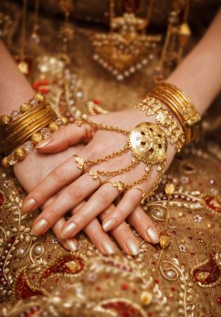 Hands of a bride in a traditional wedding jewelry close up. Sri Lanka