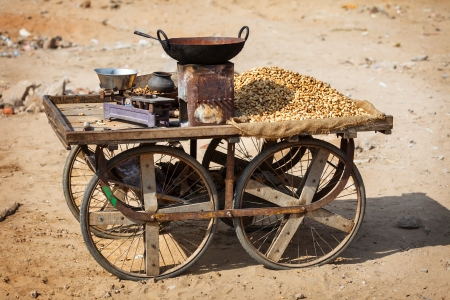 earth nut: Old mobile shop for selling roasted peanuts. India, Pushkar