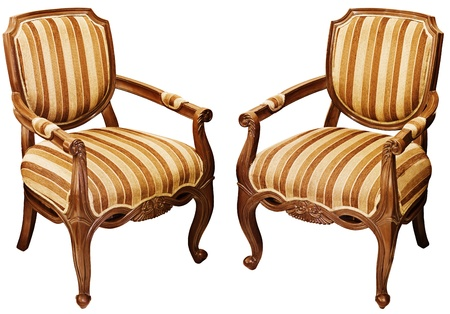 Two vintage wooden baroque armchairs isolated on white background photo
